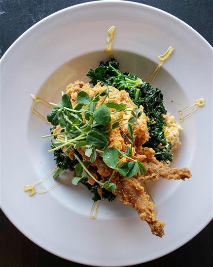 fried shrimp over sauteed spinach