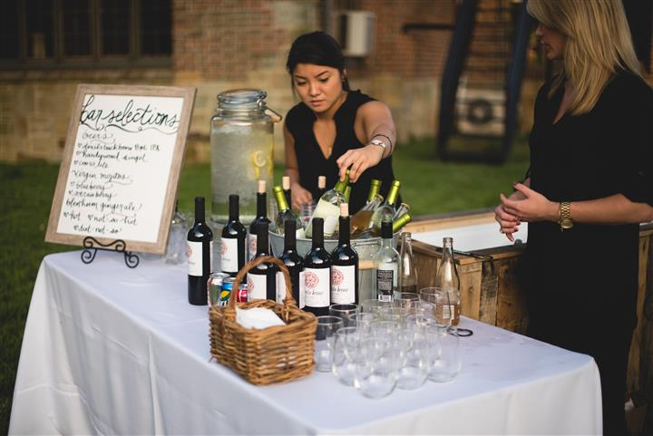 catering bartender with various wine bottles
