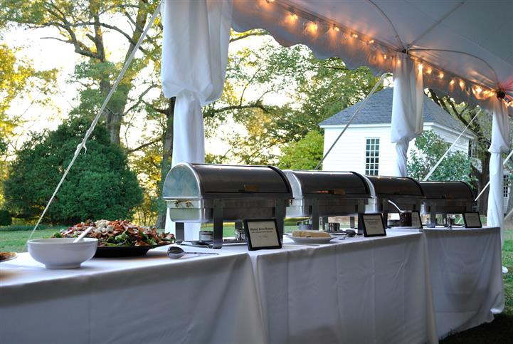 catering buffet outdoors with metal trays