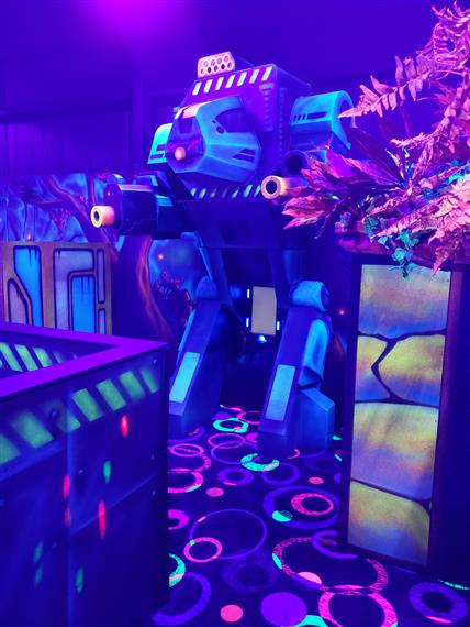 Laser Tag arena with black light and neon colored objects