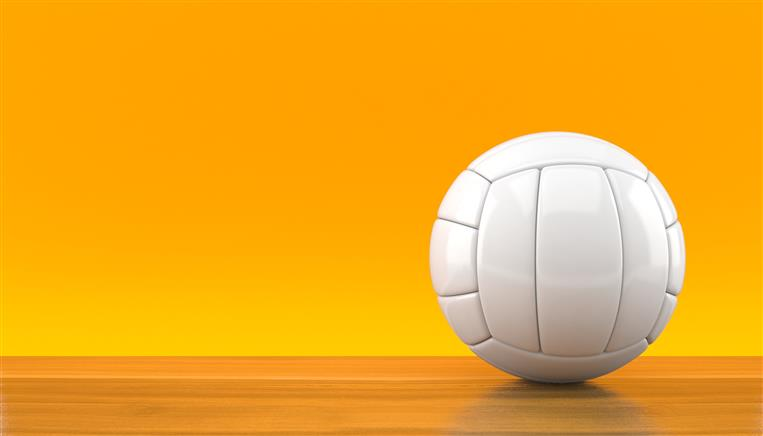 Volleyball on orange background