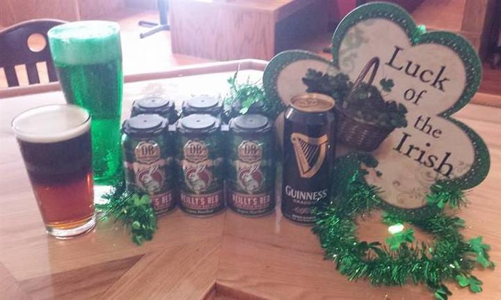 Cans of beer with St. Patricks day decor