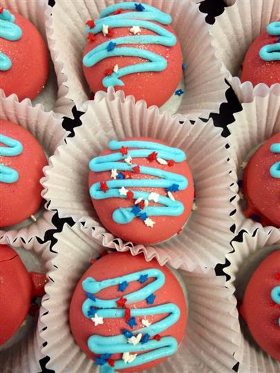 Red fudge topped with light blue decoration and white, blue and red stars