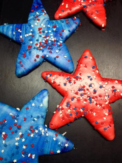 Red and blue covered cookies in star shape