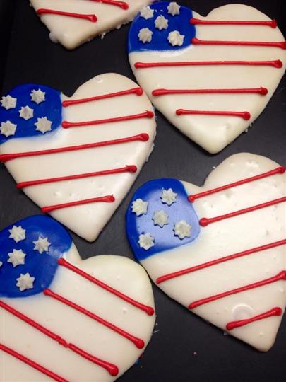 Covered white cookies in heart shape with USA flag decoration