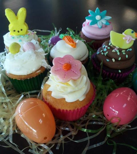 Several cupcakes with colorful Easter decoration