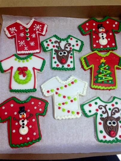 Covered cookies in t-shirt shape with christmas decoration