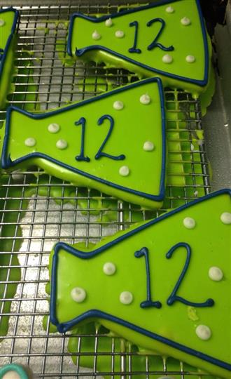 Light green covered cookies with dark green letters