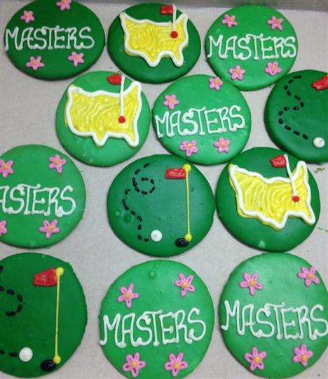 Green covered cookies topped with colorful decoration