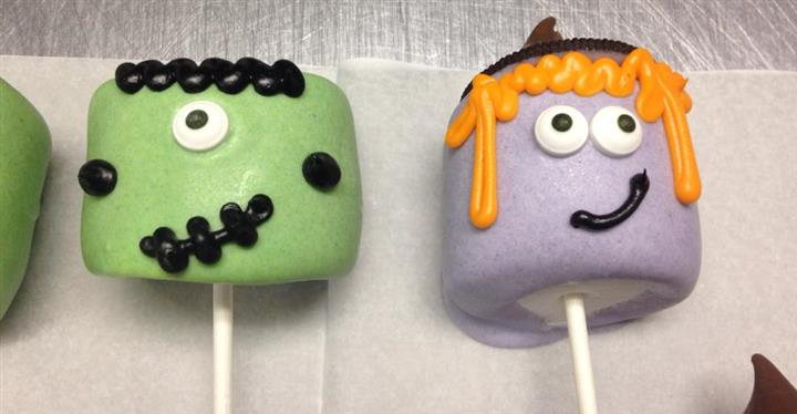 Green and violet cake pops with funny face decoration