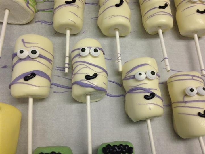 White cake pops with decoration of a funny face