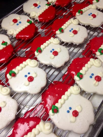 Covered cookies in the shape and colors of Santa