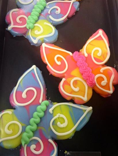 Colorful covered cookies in butterfly shape
