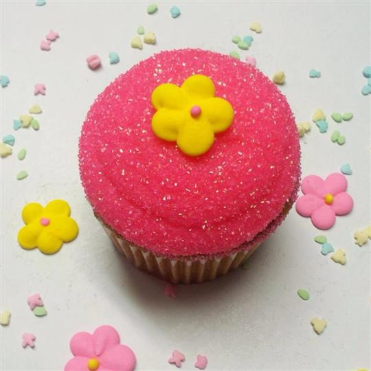 Cake Pop topped with with pink marshmallow and a yellow sugar flower