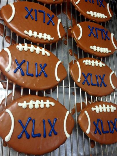 Chocolate cookies in football shape topped with milk chocolate