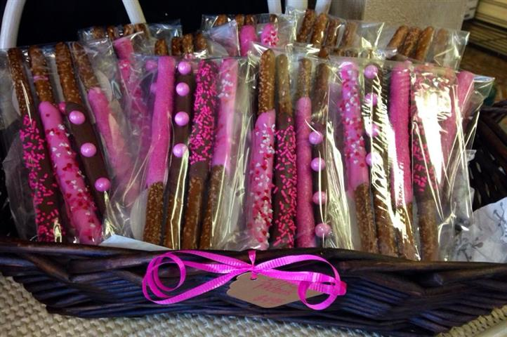 Packets of four chocolate sticks with pink toppings