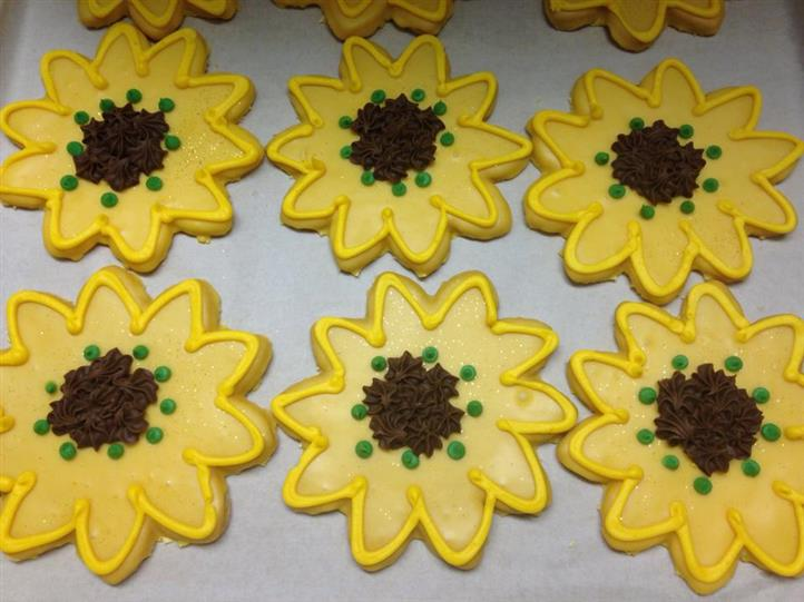 Yellow cookies in flower shapes topped with chocolate chips