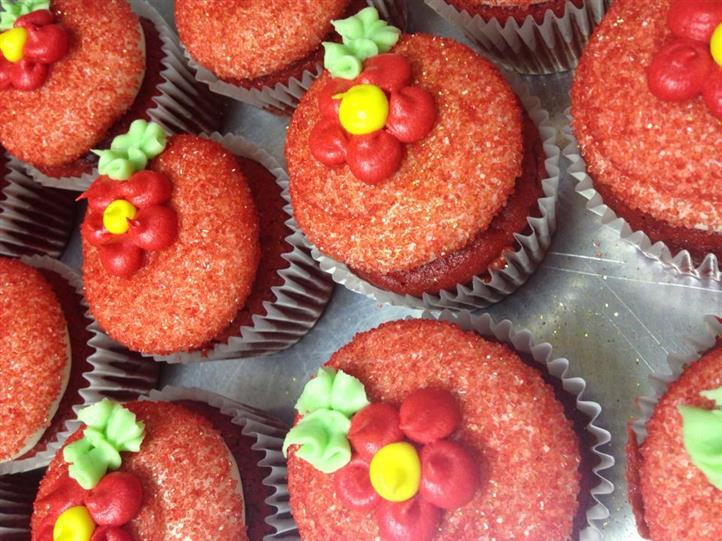 Cupcakes with chocolate fillings topped with red sugar flowers