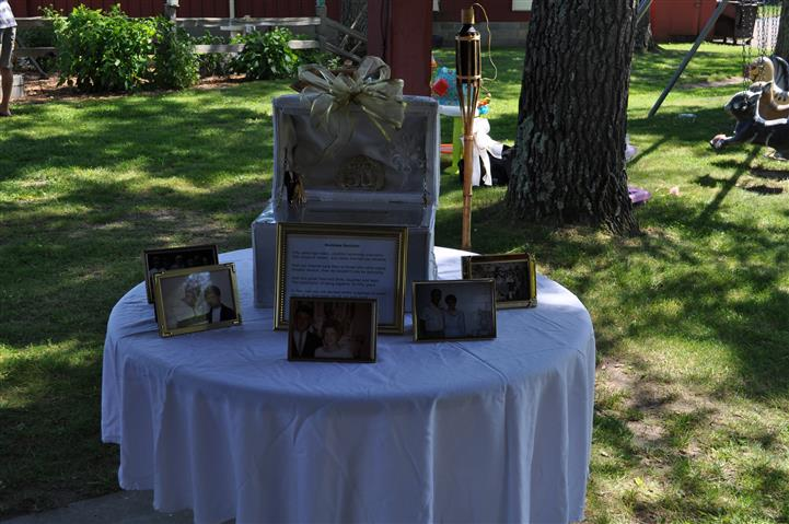 a table with framed pictures of a couple