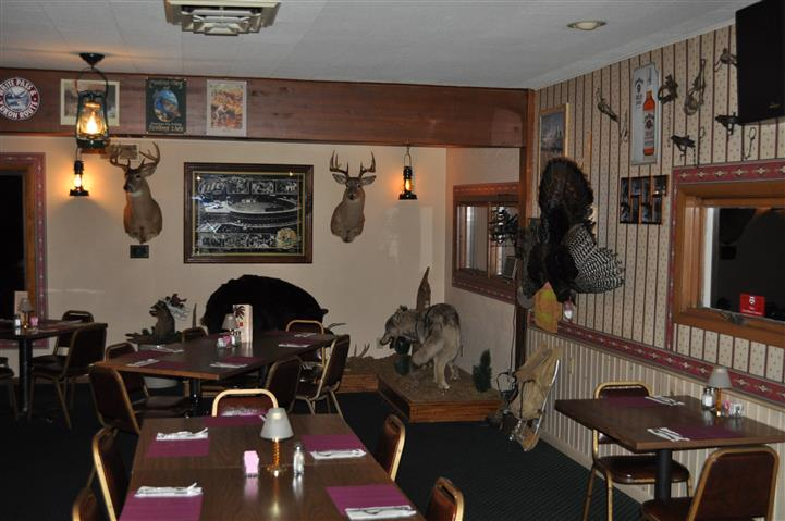 main dining area, with dining tables and various taxidermy animals