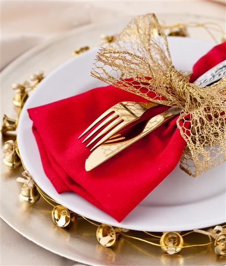 Utensils and napkin wrapped within a bow