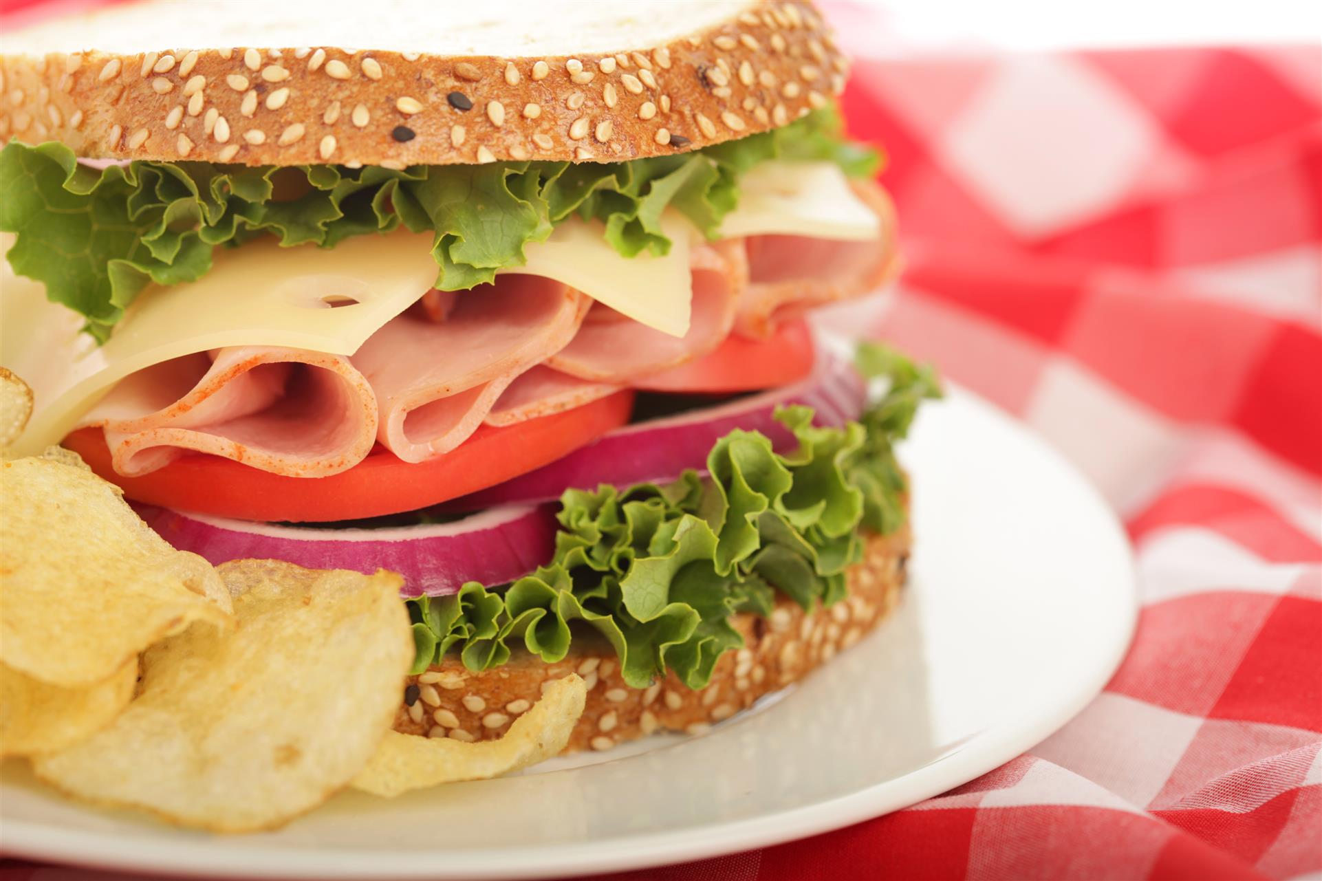 turkey sandwich with lettuce, tomato, cheese