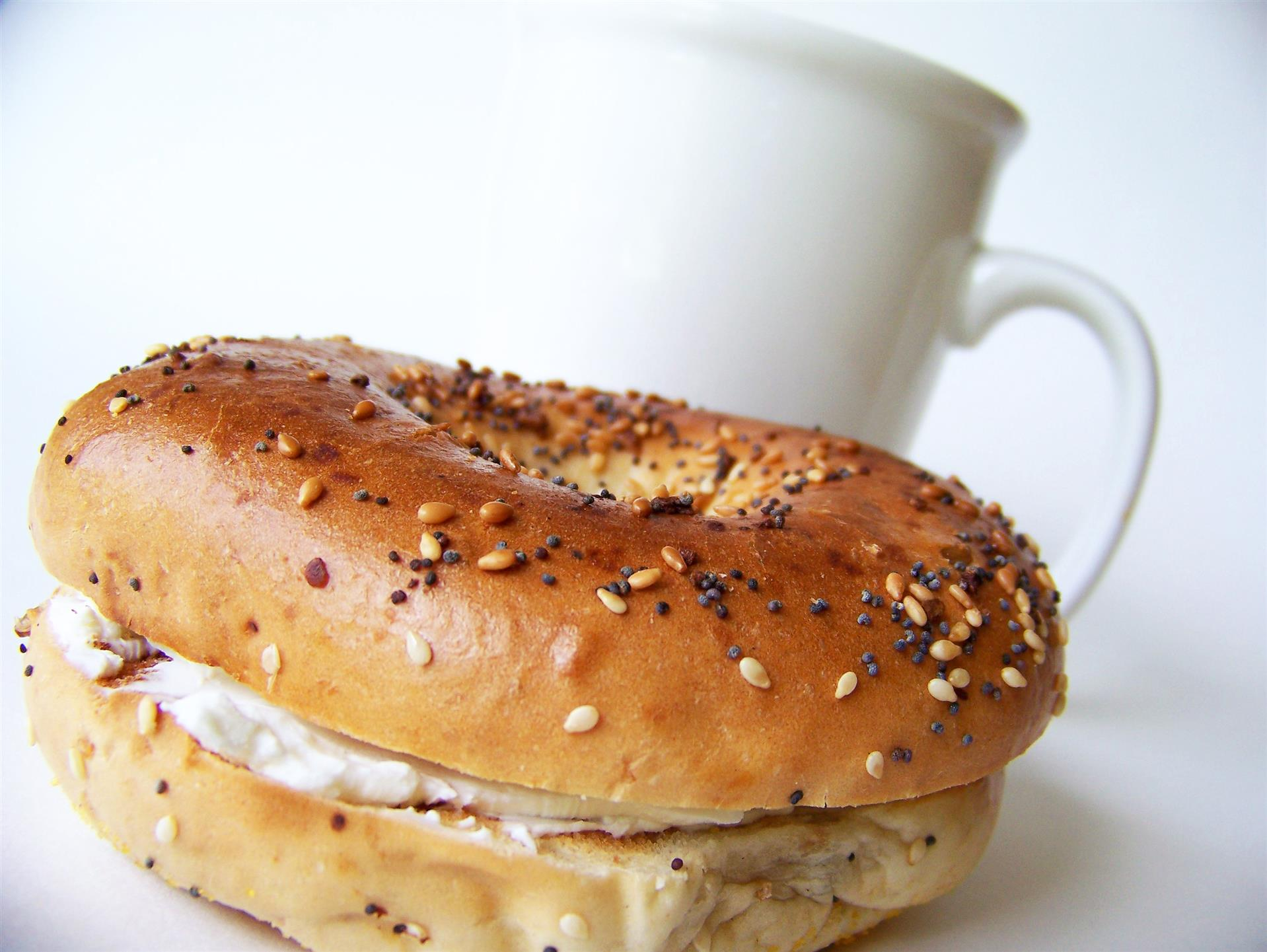 bagel with cream cheese and a cup of coffee