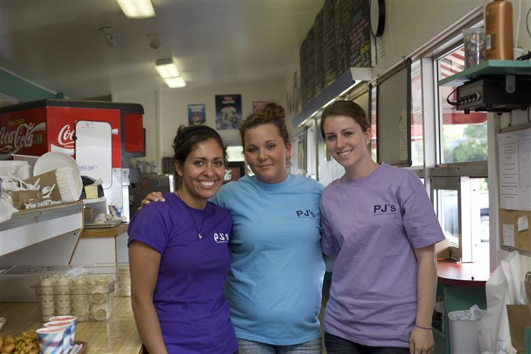 three girls smiling posing for the camera