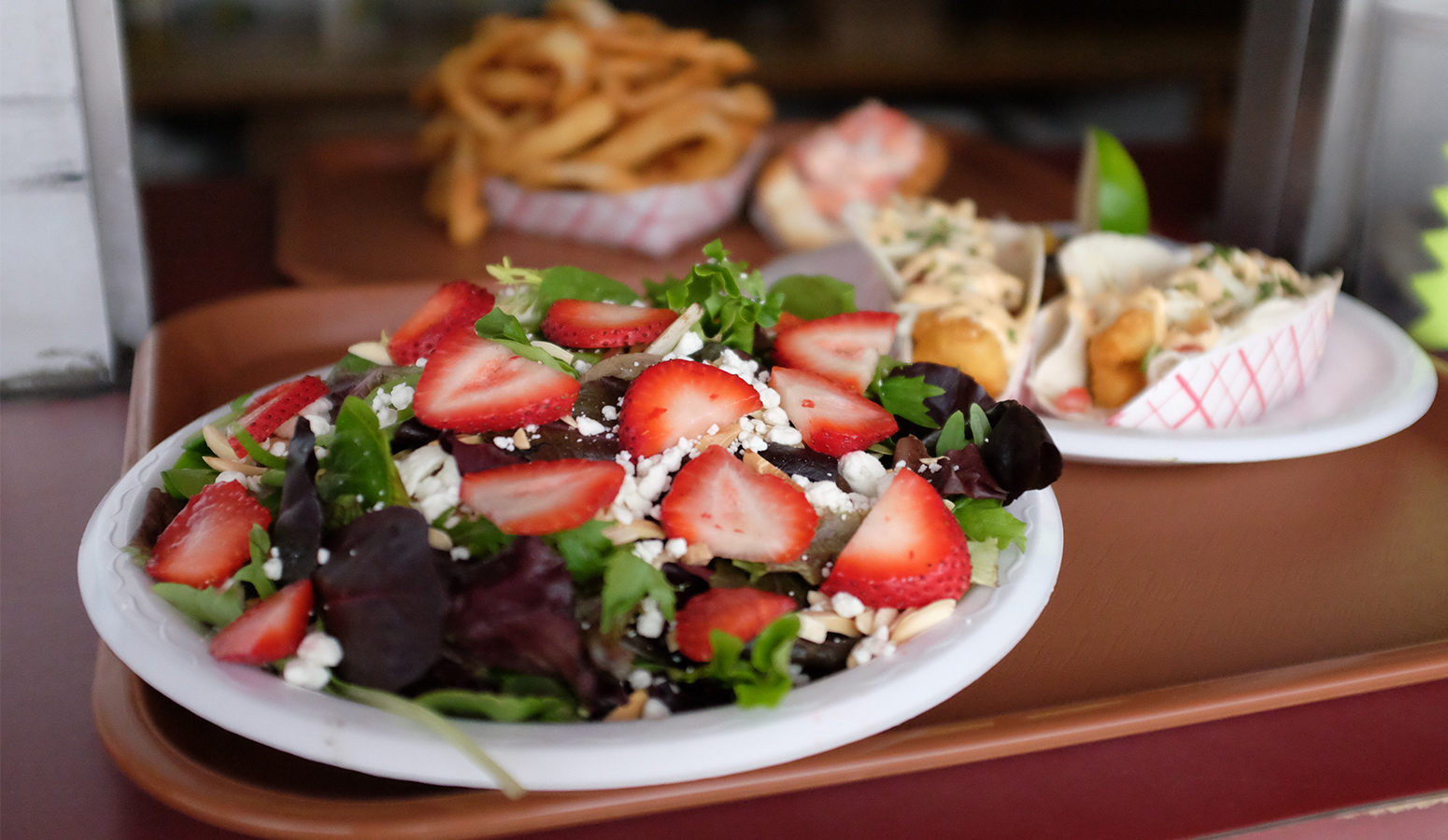 strawberry salad topped with feta cheese