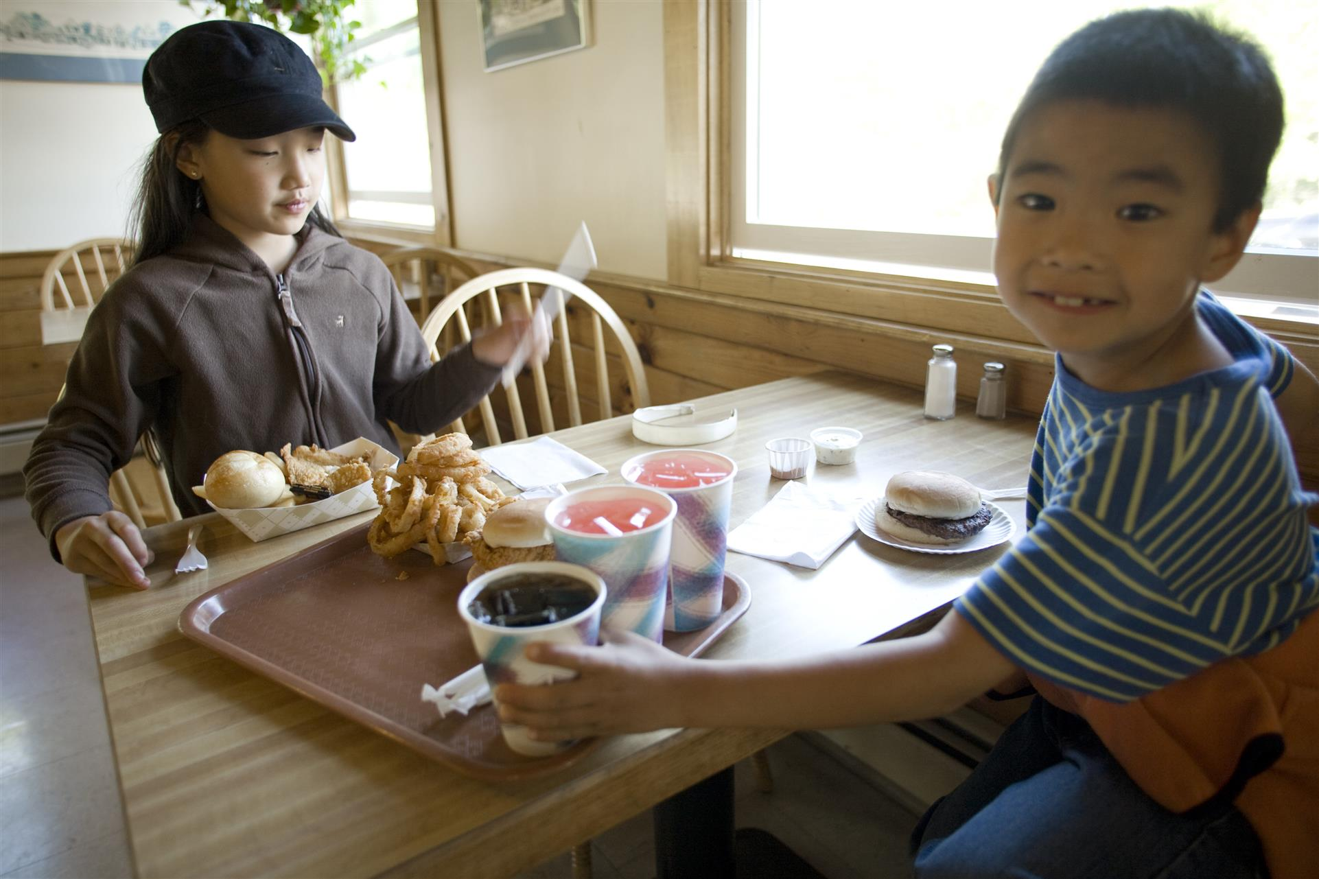 two children sitting at a table