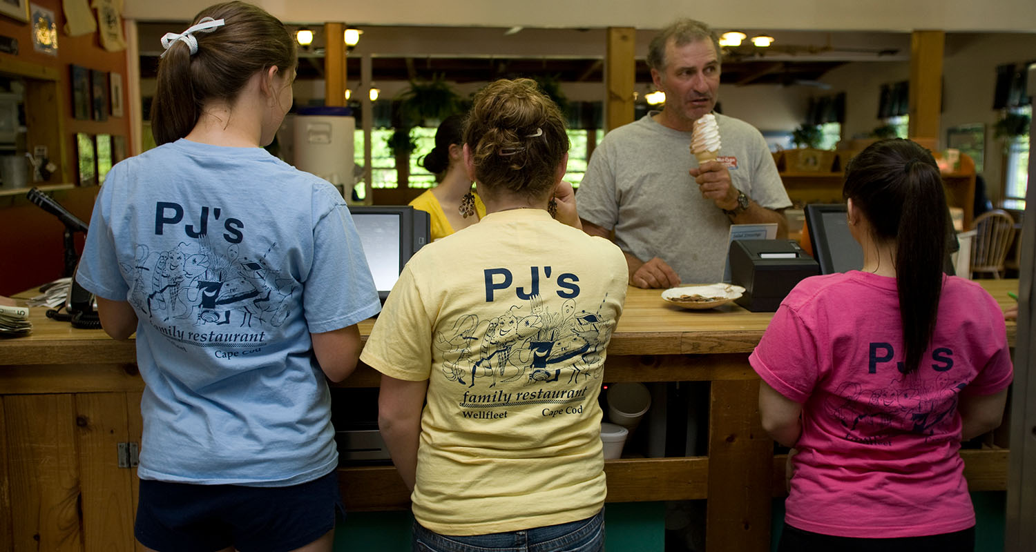 three woman standing with PJ's t shirts