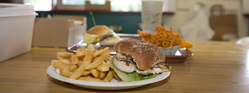 grilled chicken sandwich with a side of fries