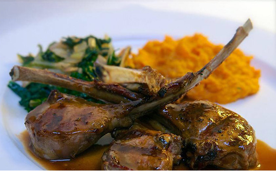 Grilled lamb chops served with carrot puree and boiled greens