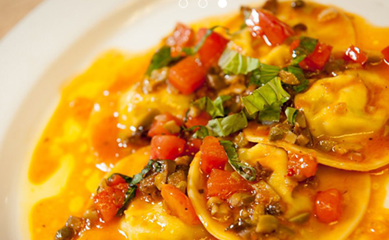 Ravioli with tomato and olives sauce