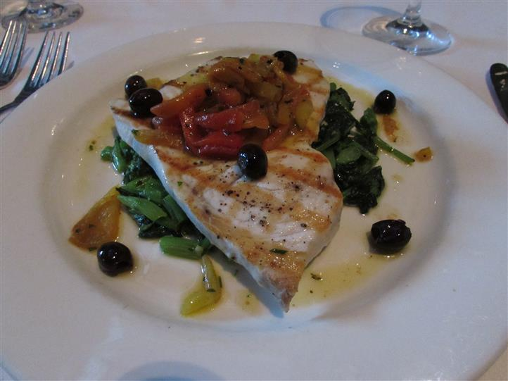 Grilled chicken breast served with roasted peppers, vegetables and kalamata olives