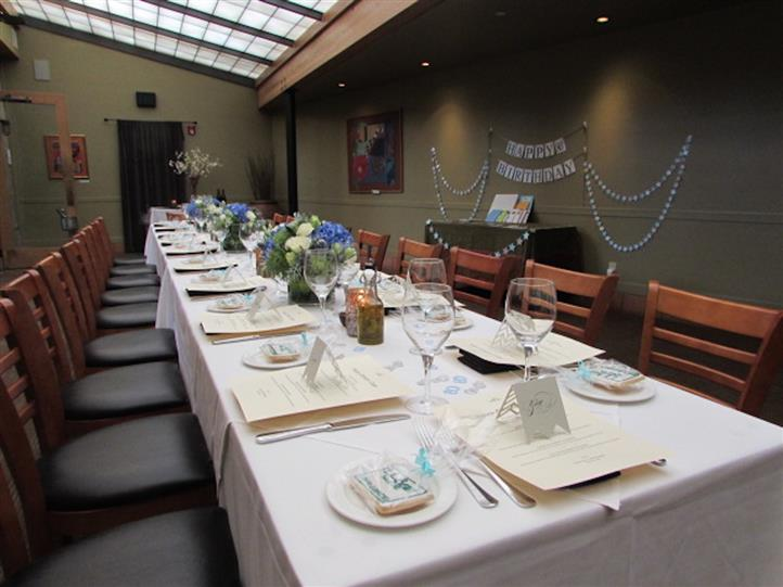 Interior shot of the restaurant with a long table decorated for a birthday party