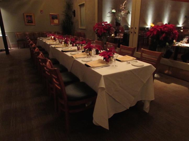 Interior shot of the restaurant with a long table