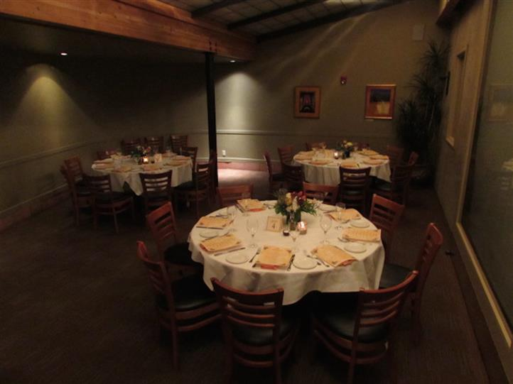 Interior shot of the restaurant with rounded tables