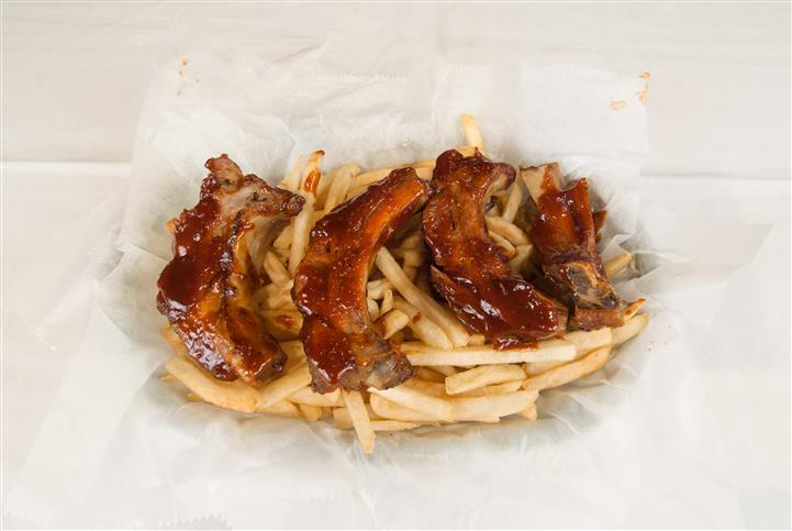 Ribs topped on french fries