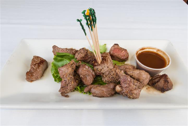 Beef served with dipping sauce