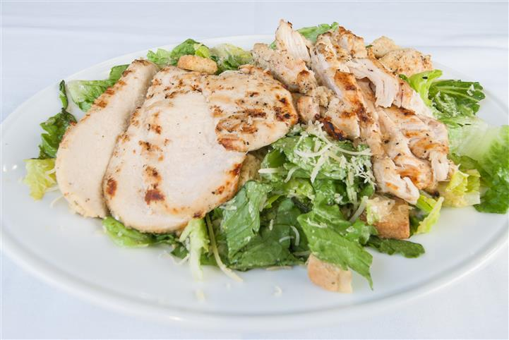 Salad topped with grilled chicken and cheese
