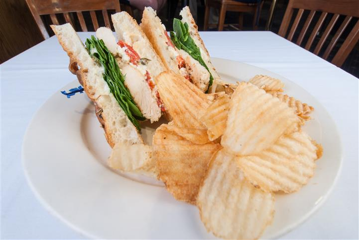 2  Halves of a sandwich with a side of chips