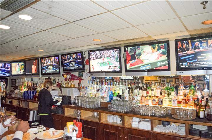 Bar area of establishment along with tv's