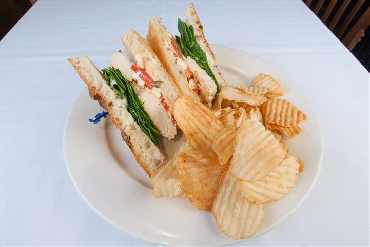 2 Sandwich halves of a sandwich with a side of chips