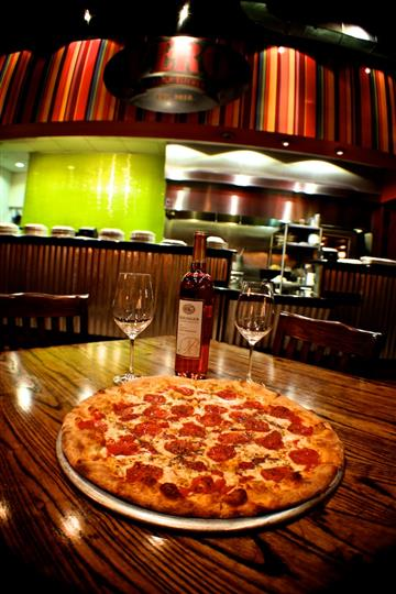 pepperoni pizza with wine & wine glasses