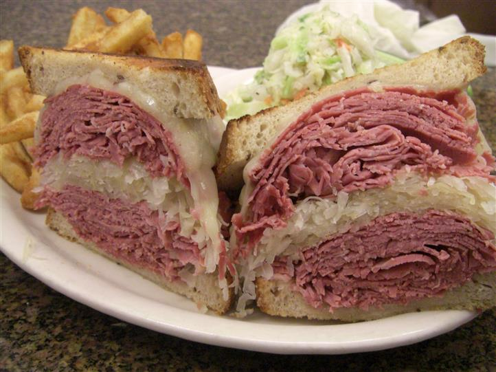 Grilled reuben. Corned Beef, Sauerkraut, Melted Imported Swiss & Russian dressing -On our Famous Grilled Rye with Fries & Slaw