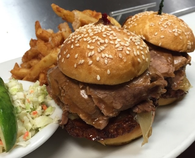 Brisket sandwich with gravy and onions, side of fries and coleslaw
