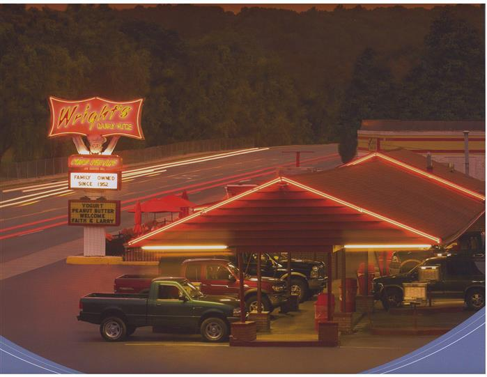 Outdoor shot of the restaurant's parking by night