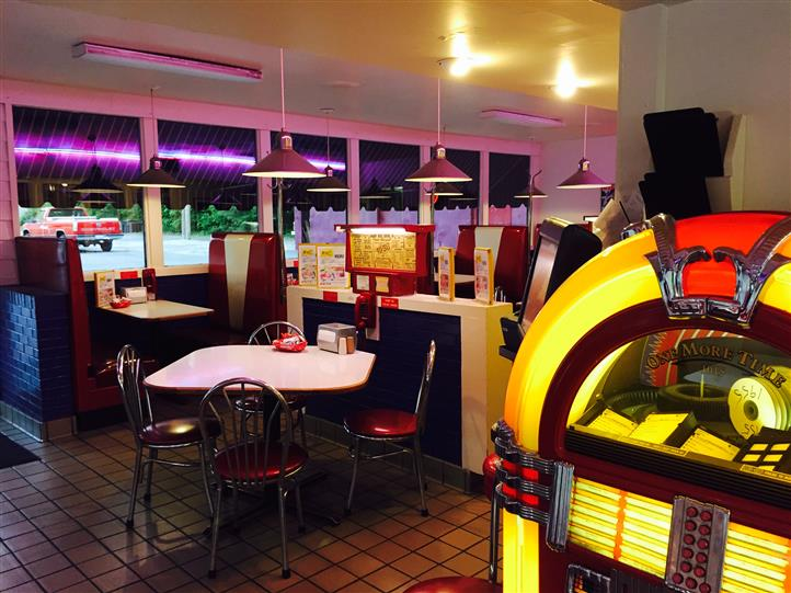 Interior shot of the restaurant with a jukebox
