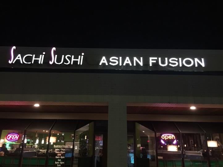 "storefront with lighted sign that reads, ""Sachi Sushi Asian Fusion"""